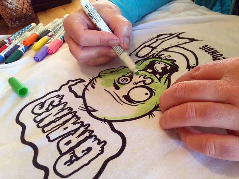 Color a t-shirt with fabric markers